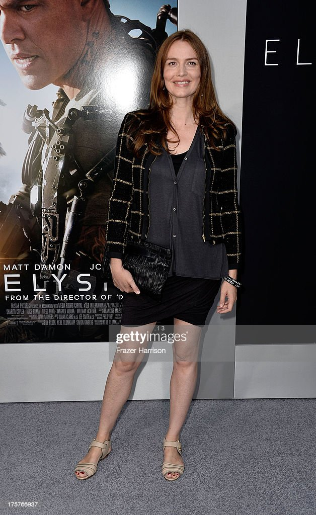 Actress Saffron Burrows arrives at the Premiere of TriStar Pictures' 'Elysium' oat Regency Village Theatre on August 7, 2013 in Westwood, California.