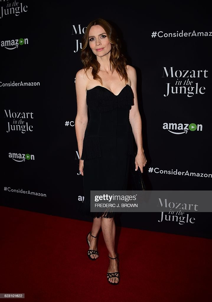 Actress Saffron Burrows poses on arrival for a Special Screening of 'Mozart In The Jungle' in Hollywood, California on April 21, 2016. / AFP / FREDERIC
