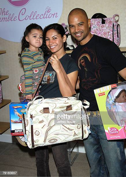 Actress Salli Richardson Whitfield husband Dondre Whitfield and daughter Parker attend the Boom Boom Room Gifting Wonderland at the Century Plaza...