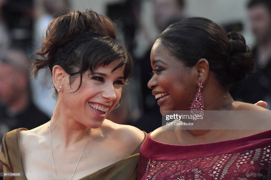 Actress Sally Hawkins (L) and actress Octavia Spencer arrive at the premiere of the movie 'The Shape of Water' presented in competition 'Venezia 74' at the 74th Venice Film Festival on August 31, 2017 at Venice Lido. / AFP PHOTO / Tiziana FABI