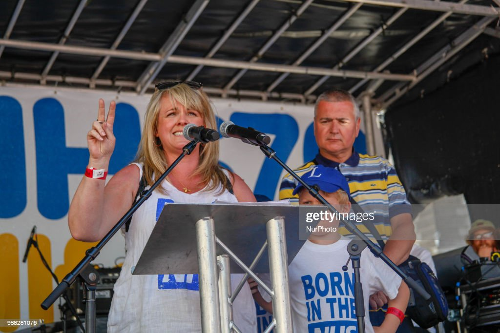 """Actress Sally Lindsay speaks at a demonstration and celebration march to mark the 70th anniversary of the National Health Service (NHS), in central London on June 30, 2018. Tens of thousands of people braved hot weather Saturday to march through London to """"celebrate and demonstrate"""" over Britain's National Health Service (NHS), ahead of its 70th birthday next week."""