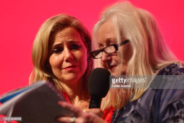 Actress Sally Phillips listens to Aneira Thomas the first person to be born on the NHS speak a the leadership campaign rally for Labour leadership...