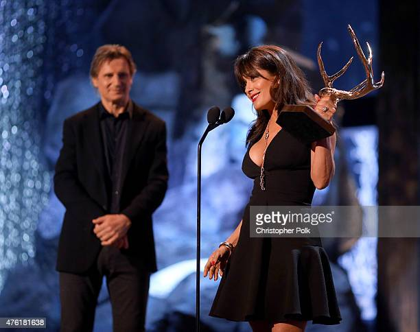 Actress Salma Hayek accepts the Decade of Hotness award from actor Liam Neeson onstage during Spike TV's Guys Choice 2015 at Sony Pictures Studios on...