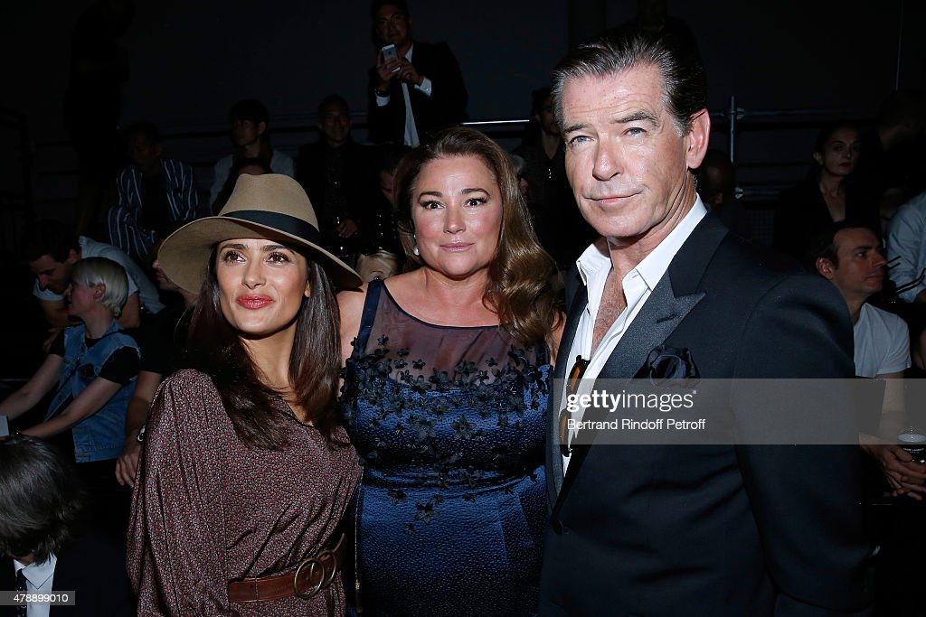 Actress Salma Hayek and Actor Pierce Brosnan with his wife Journalist Keely Shaye Smith attend the Saint Laurent Menswear Spring/Summer 2016 show as part of Paris Fashion Week on June 28, 2015 in Paris, France.