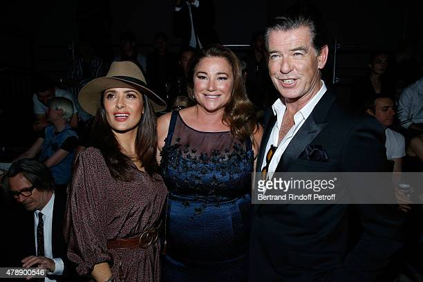 Actress Salma Hayek and Actor Pierce Brosnan with his wife Journalist Keely Shaye Smith attend the Saint Laurent Menswear Spring/Summer 2016 show as...