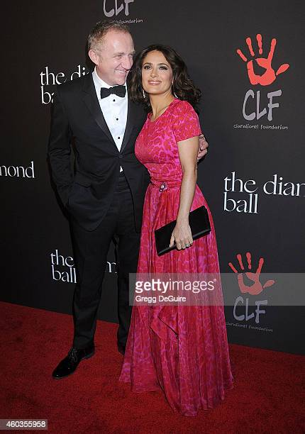 Actress Salma Hayek and FrancoisHenri Pinault arrive at Rihanna's First Annual Diamond Ball at The Vineyard on December 11 2014 in Beverly Hills...