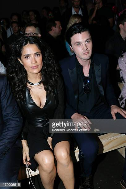 Actress Salma Hayek and Michael Pitt attend Yves Saint Laurent Menswear Spring/Summer 2014 show as part of Paris Fashion Week on June 30 2013 in...