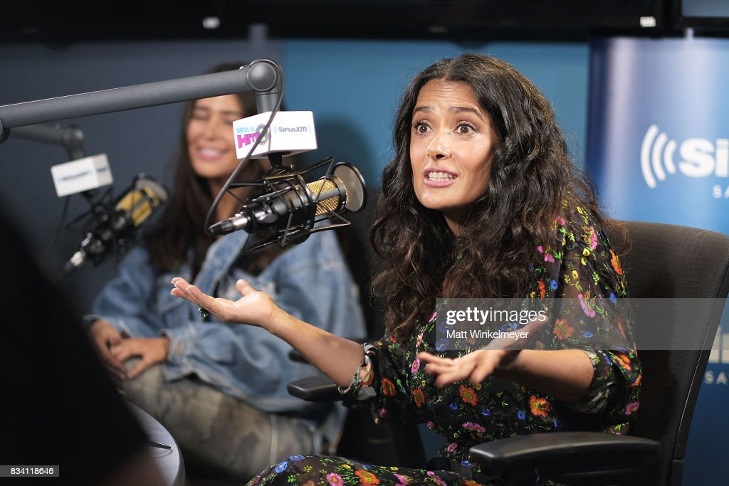 Actress Salma Hayek (R) and SiriusXM host Symon (L) speak on air as Salma Hayek visits the SiriusXM Studios on August 17, 2017 in Los Angeles, California.