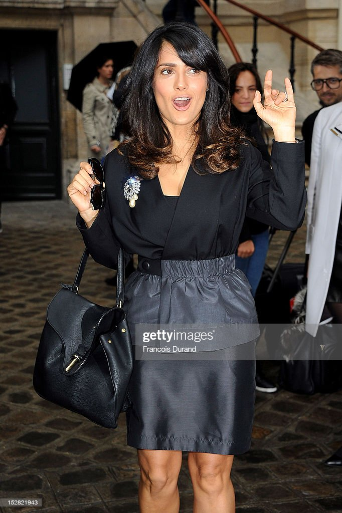 Actress Salma Hayek arrives at the Balmain Spring / Summer 2013 show as part of Paris Fashion Week at Grand Hotel Intercontinental on September 27, 2012 in Paris, France.