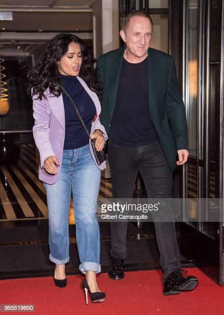 Actress Salma Hayek Pinault and husband chairman and CEO of Kering/chairman of Groupe Artemis FrancoisHenri Pinault are seen leaving a hotel in the...