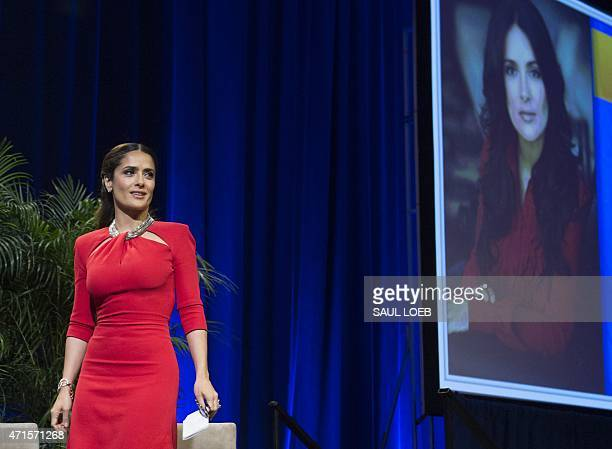 Actress Salma Hayek Pinault arrives to receive the Individual Achievement Award for her work at the Salma Hayek Foundation and Chime for Change as...