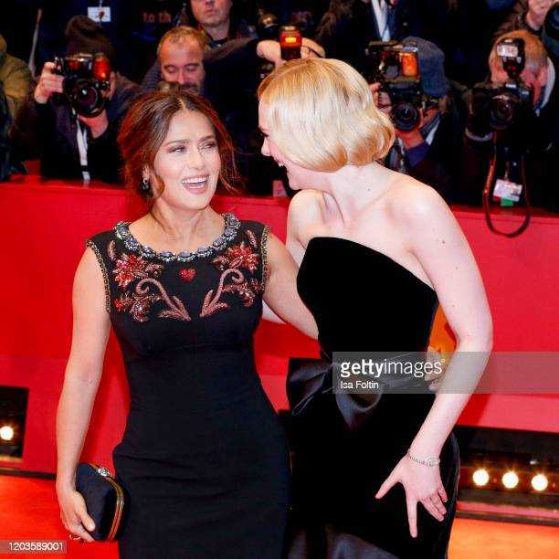 "Actress Salma Hayek pose and actress Elle Fanning at the ""The Roads Not Taken"" premiere during the 70th Berlinale International Film Festival Berlin..."