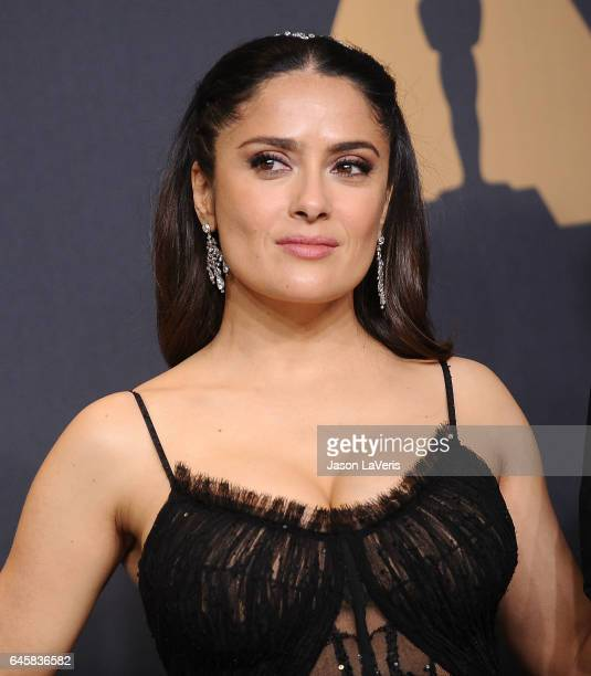 Actress Salma Hayek poses in the press room at the 89th annual Academy Awards at Hollywood Highland Center on February 26 2017 in Hollywood California