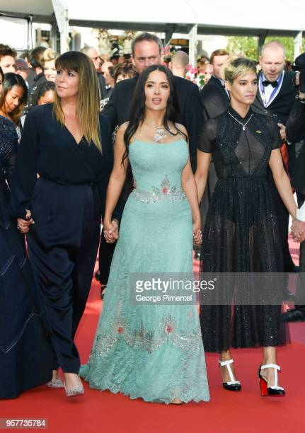 Actress Salma Hayek walks the red carpet in protest of the lack of female filmmakers honored throughout the history of the festival at the screening...