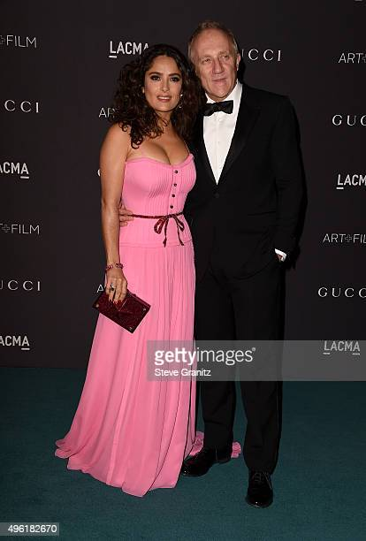 Actress Salma Hayek wearing Gucci and businessman FrancoisHenri Pinault attend LACMA 2015 ArtFilm Gala Honoring James Turrell and Alejandro G...