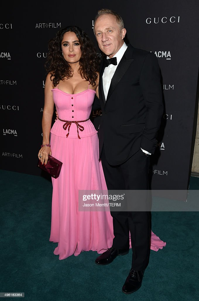 Actress Salma Hayek, wearing Gucci, (L) and Francois-Henri Pinault attend LACMA 2015 Art+Film Gala Honoring James Turrell and Alejandro G Iñárritu, Presented by Gucci at LACMA on November 7, 2015 in Los Angeles, California.