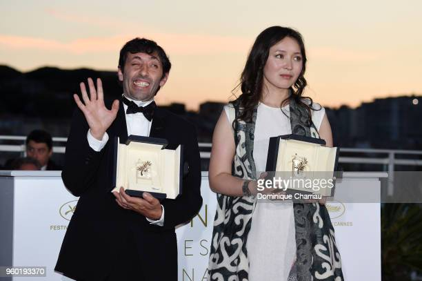 Actress Samal Yeslyamova poses with the Best Actress award for her role in 'Ayka' and actor Marcello Fonte poses with the Best Actor award for his...