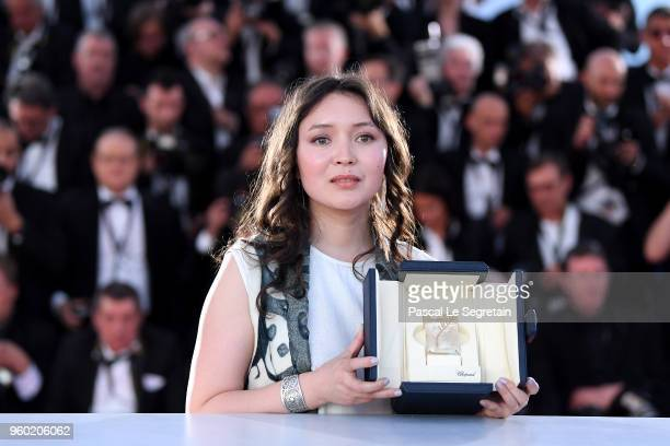 Actress Samal Yeslyamova poses with the Best Actress award for her role in 'Ayka' at the photocall for the Palme D'Or Winner during the 71st annual...
