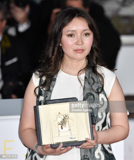 Actress Samal Yeslyamova poses with the Best Actress award for her role in 'Ayka' during the photocall at the 71st Cannes Film Festival in Cannes...