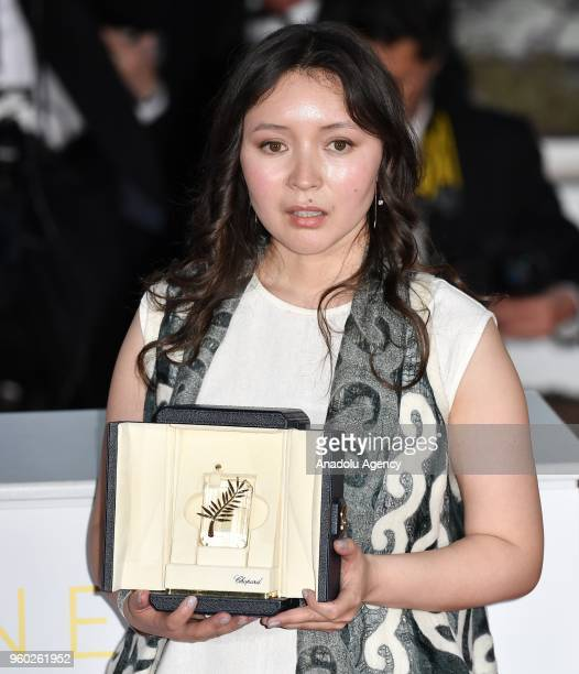 Actress Samal Yeslyamova poses with the Best Actress award for her role in 'Ayka' during the photocall at the 71st Cannes Film Festivall in Cannes...