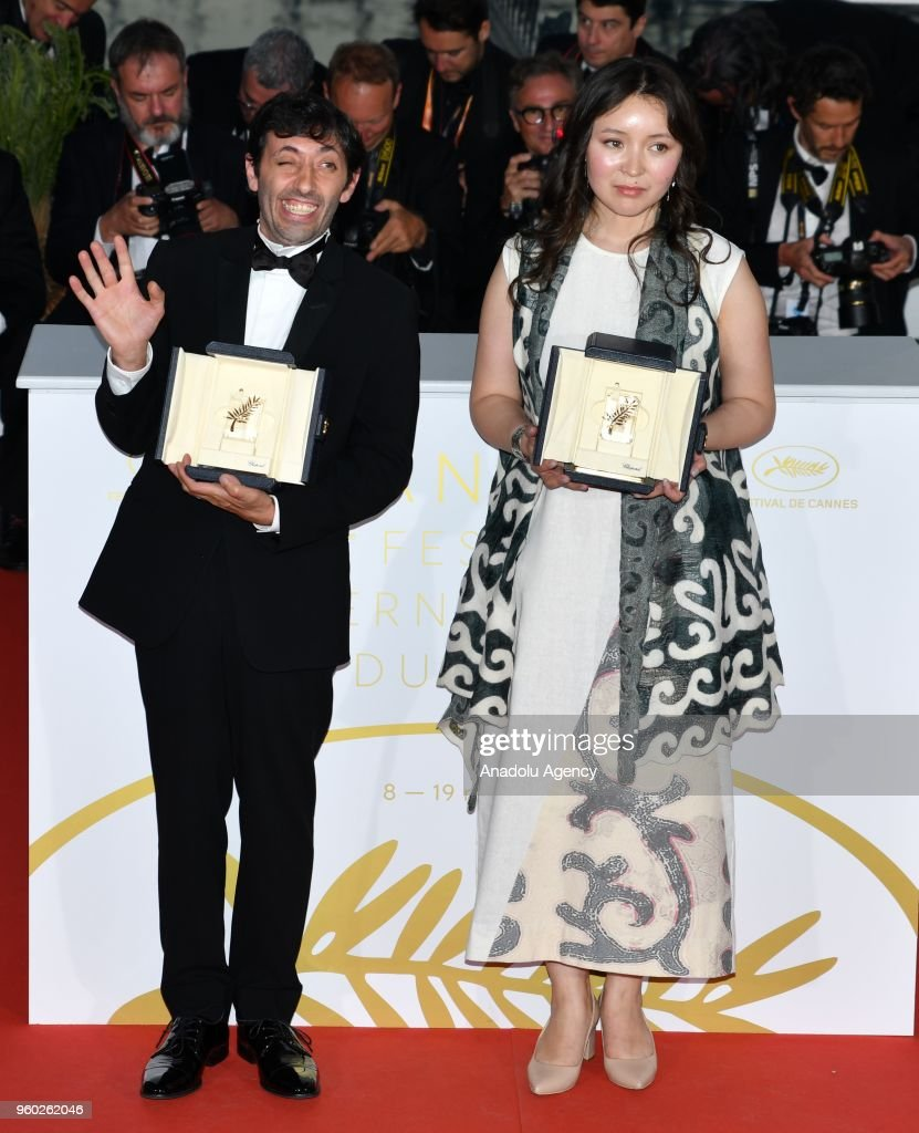 Actress Samal Yeslyamova (R) poses with the Best Actress award for her role in 'Ayka' (The Little One) and actor Marcello Fonte (L) poses with the Best Actor award for his role in 'Dogman' during the photocall at the 71st Cannes Film Festival in Cannes, France on May 19, 2018.