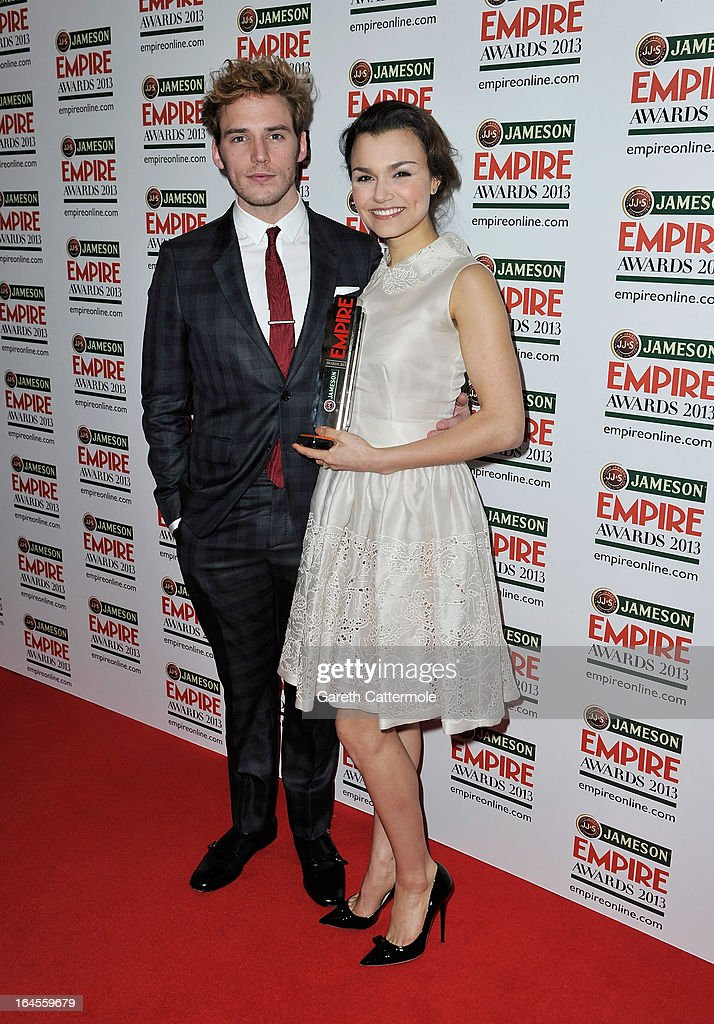 Actress Samantha Barks with the Best Female Newcomer award with presenter Sam Claflin at the Jameson Empire Awards 2013 at Grosvenor House on March 24, 2013 in London, England.