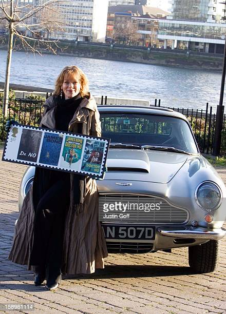 Actress Samantha Bond Who Played Miss Moneypenny In The James Bond Films Poses With An Aston Martin Db6 At Millbank In London To Launch A New Set Of...
