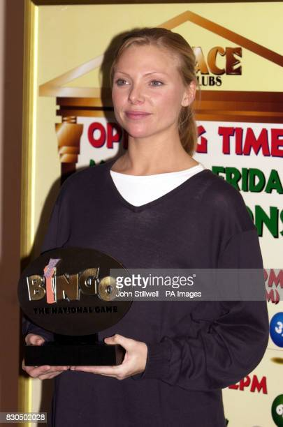 Actress Samantha Janus with the trophy she presented to Phil Groom who was declared Britain's Bingo Caller of the Year at the Palace Bingo Club at...