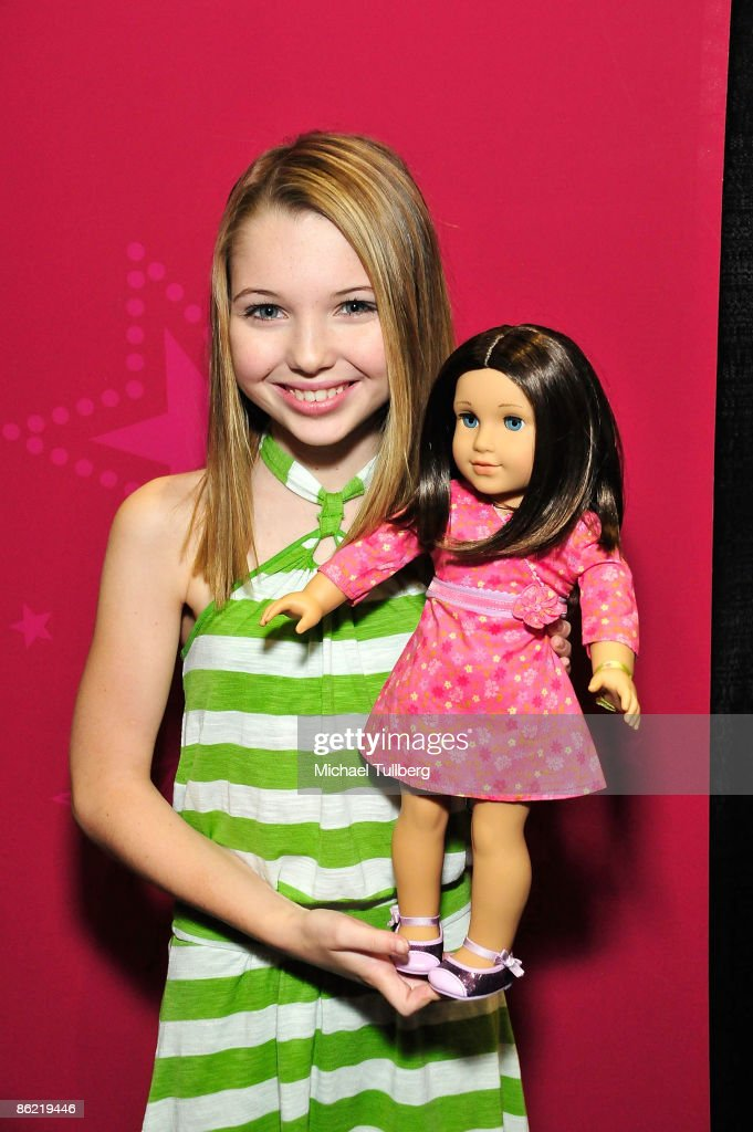 Actress Sammi Hanratty poses with American Girl doll 'Chrissa' at the Baby & Tween Celebration trade show at the Los Angeles Convention Center on April 25, 2009 in Los Angeles, California.