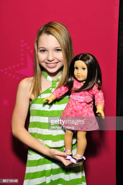 Actress Sammi Hanratty poses with American Girl doll 'Chrissa' at the Baby Tween Celebration trade show at the Los Angeles Convention Center on April...