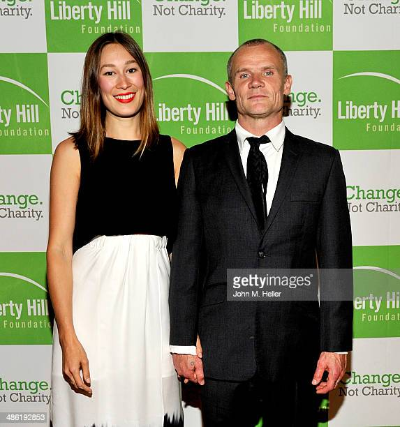 Actress Sandah Khin and musician/actor Flea attend the Liberty Hill's Upton Sinclair Awards dinner at The Beverly Hilton Hotel on April 22 2014 in...