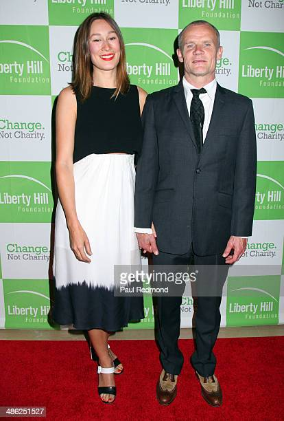 Actress Sandha Khin and musician Flea arriving at Liberty Hill Foundation's Annual Upton Sinclair Dinner at The Beverly Hilton Hotel on April 22 2014...