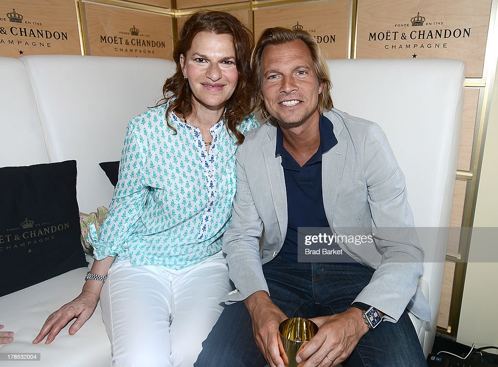 Actress Sandra Bernhard(L) and U.S. vice president of Champagne maker Moet & Chandon Ludovic du Plessis attend The Moet & Chandon Suite at USTA Billie Jean King National Tennis Center on August 29, 2013 in New York City.