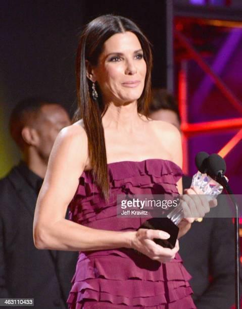 Actress Sandra Bullock accepts her award onstage at the 19th Annual Critics' Choice Movie Awards at Barker Hangar on January 16 2014 in Santa Monica...