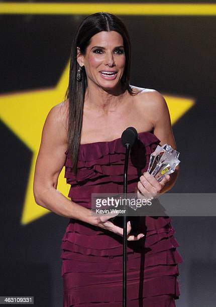 Actress Sandra Bullock accepts the award for Best Actress in an Action Movie for 'Gravity' onstage during the 19th Annual Critics' Choice Movie...