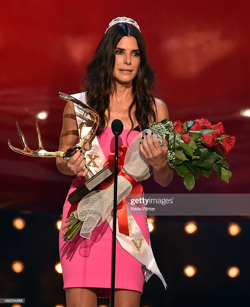 Actress Sandra Bullock accepts the award for 'Decade of Hotness' onstage during Spike TV's 'Guys Choice 2014' at Sony Pictures Studios on June 7, 2014 in Culver City, California.