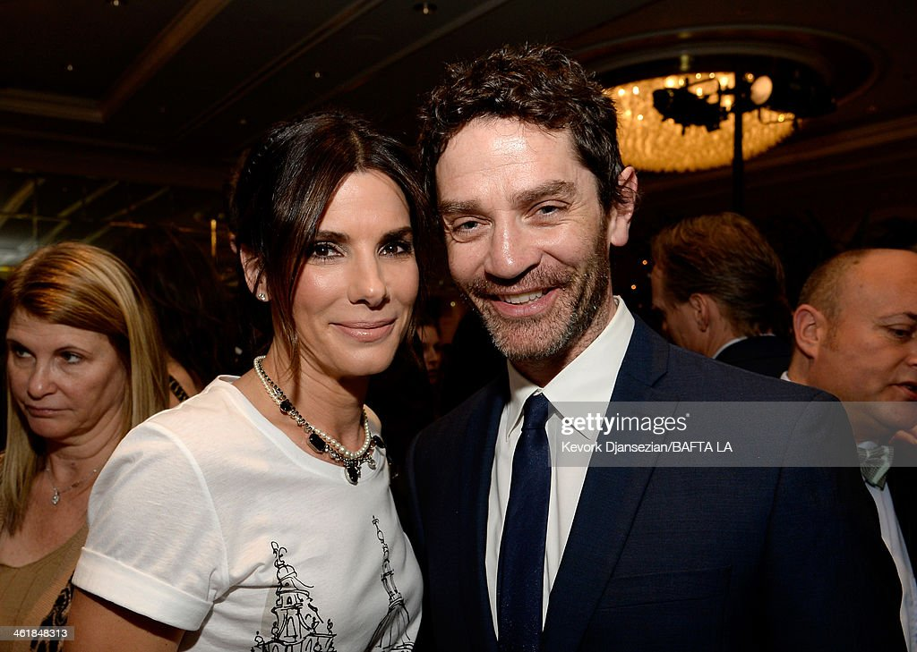 Actress Sandra Bullock (L) and actor James Frain attend the BAFTA LA 2014 Awards Season Tea Party at the Four Seasons Hotel Los Angeles at Beverly Hills on January 11, 2014 in Beverly Hills, California.