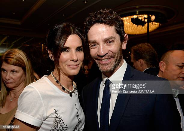 Actress Sandra Bullock and actor James Frain attend the BAFTA LA 2014 Awards Season Tea Party at the Four Seasons Hotel Los Angeles at Beverly Hills...