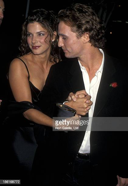 Actress Sandra Bullock and actor Matthew McConaughey attend the 'In Love and War' Los Angeles Premiere on January 20 1997 at DGA Theatre in Hollywood...