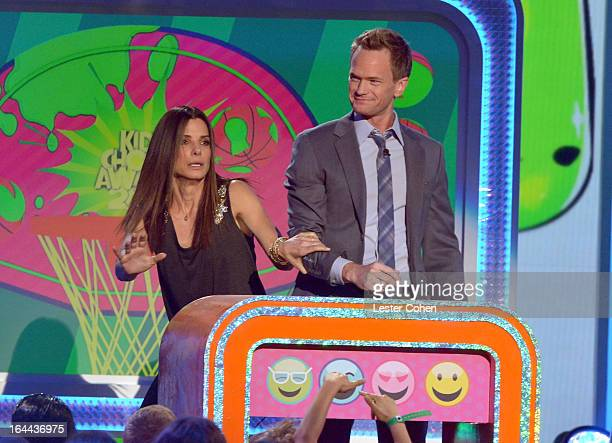 Actress Sandra Bullock and actor Neil Patrick Harris perform during Nickelodeon's 26th Annual Kids' Choice Awards at USC Galen Center on March 23...