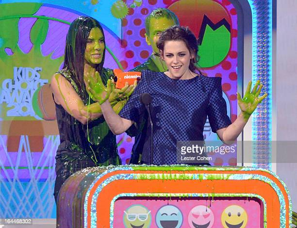 Actress Sandra Bullock and actress Kristen Stewart perform during Nickelodeon's 26th Annual Kids' Choice Awards at USC Galen Center on March 23 2013...