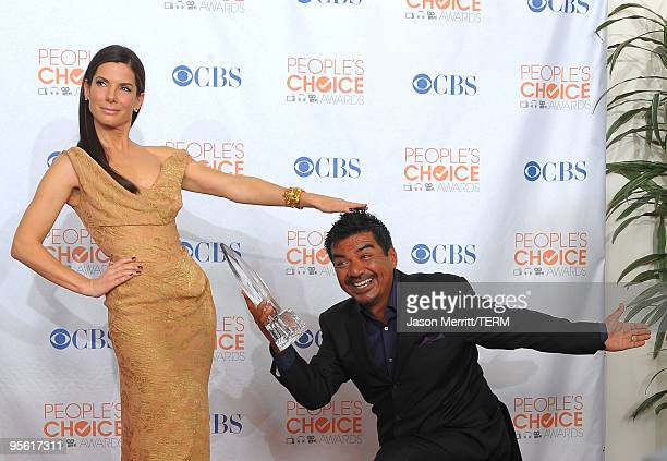 Actress Sandra Bullock and comedian George Lopez pose with Bullock's Favorite Movie Actress award in the press room during the People's Choice Awards...