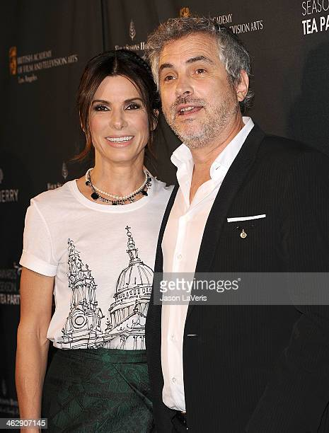 Actress Sandra Bullock and director Alfonso Cuaron attend the BAFTA LA 2014 awards season tea party at Four Seasons Hotel Los Angeles at Beverly...