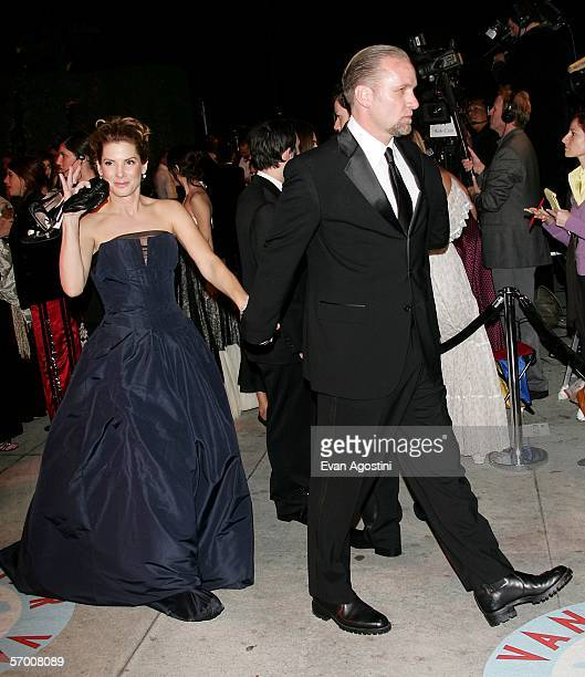 Actress Sandra Bullock and her husband Jesse James leave the Vanity Fair Oscar Party at Mortons on March 5, 2006 in West Hollywood, California.