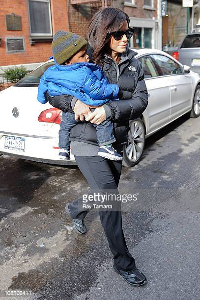Actress Sandra Bullock and her son Louis Bullock leave their Soho home on January 20, 2011 in New York City.