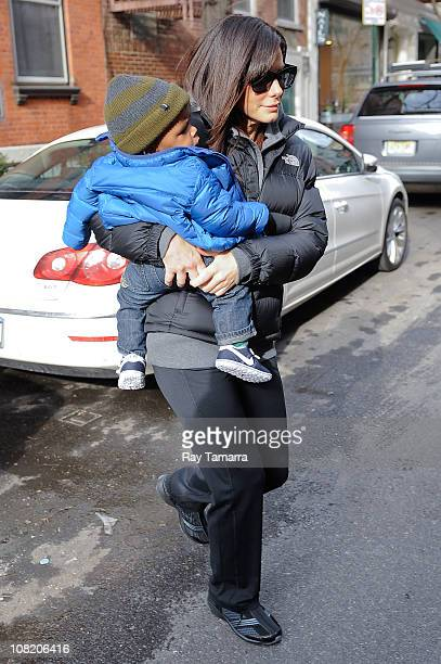 Actress Sandra Bullock and her son Louis Bullock leave their Soho home on January 20 2011 in New York City