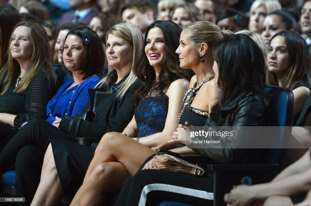 Actress Sandra Bullock (C) and TV personality Heidi Klum in the audience at the 39th Annual People's Choice Awards at Nokia Theatre L.A. Live on January 9, 2013 in Los Angeles, California.