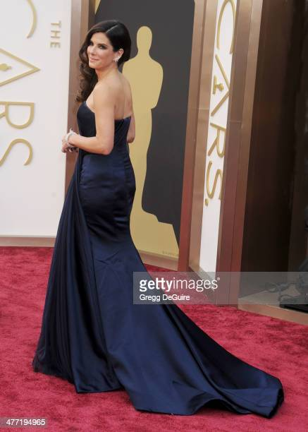 Actress Sandra Bullock arrives at the 86th Annual Academy Awards at Hollywood Highland Center on March 2 2014 in Hollywood California