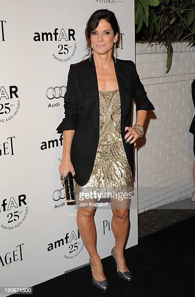 Actress Sandra Bullock arrives at the amfAR Inspiration Gala at Chateau Marmont on October 27 2011 in Los Angeles California