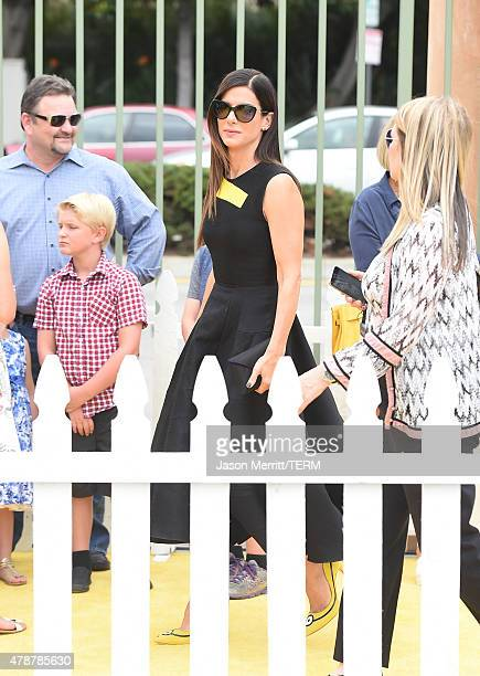 Actress Sandra Bullock arrives at the Los Angeles premiere of 'Minions' held at the Shrine Auditorium on Saturday June 27 2015